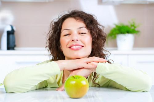 dieting concept healthy food young woman eats fresh fruit