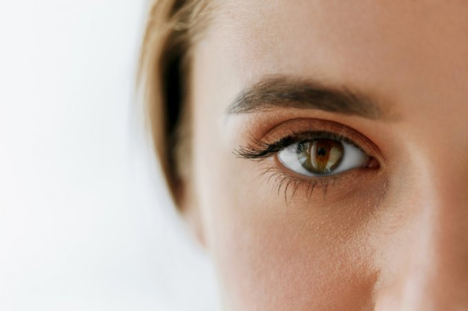 eye health and care closeup of beautiful woman big brown eye and eyebrow girl eye smooth healthy skin and perfect natural...