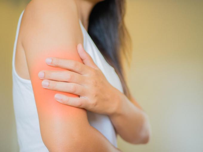 closeup female's arm arm pain and injury health care and medical concept