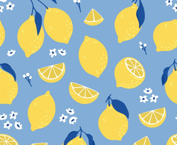 tropical seamless pattern with yellow lemons summer print with citrus, lemons slices, fresh fruits and flowers in hand dr...