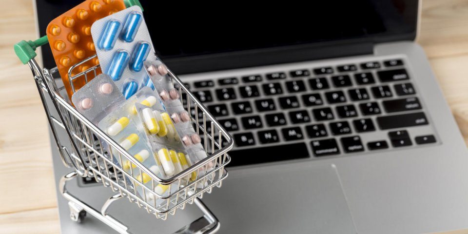 shopping cart with different tablets on notebook keyboard