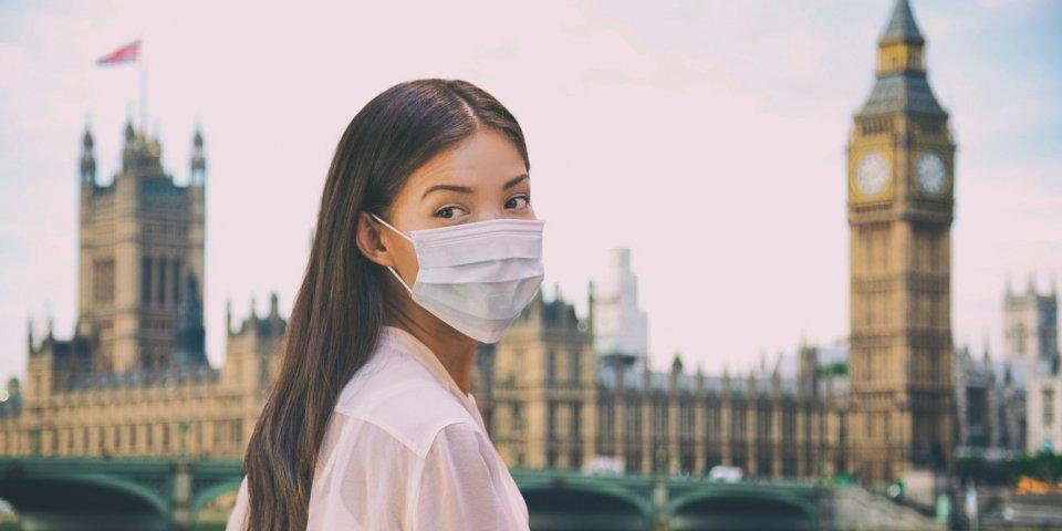 corona virus travel corona virus spread prevention asian woman tourist wearing protective face mask on uk london city sig...