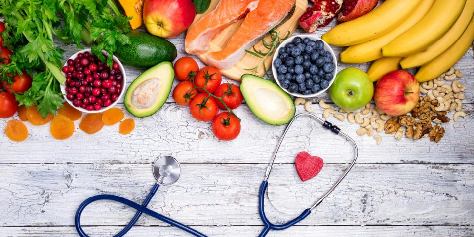 healthy food for heart fresh fish, fruits, vegetables, berries and nuts healthy food, diet and healthy heart concept top view