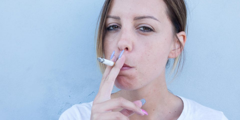 girl smokes the cigarette with so many health problems