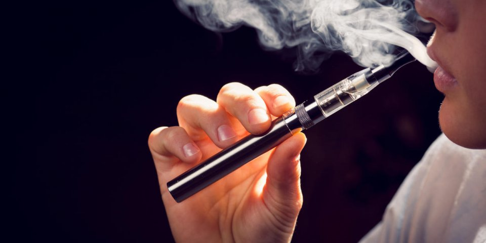 close up of inhaling from an electronic cigarette