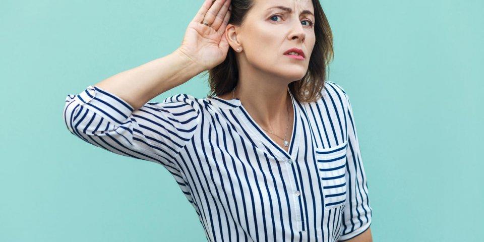 i can not hear you beautiful business lady studio shot, light blue background