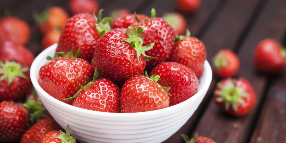 fresh strawberries on wooden background copy space