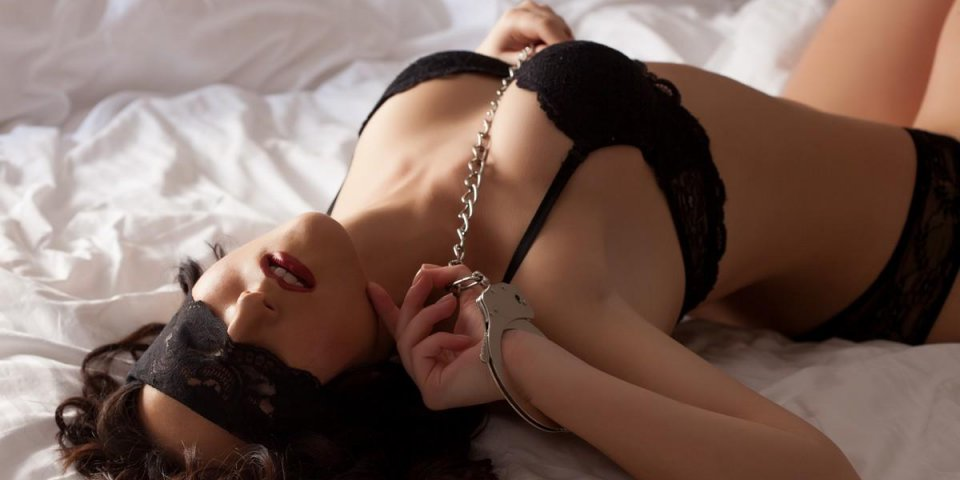 image of excited submissive in bed, close-up