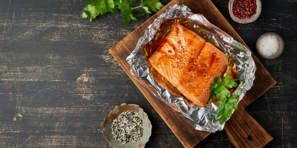 foil pack dinner with fish fillet of salmon copy space healthy diet food, keto diet, mediterranean cuisine oven-baked hot...