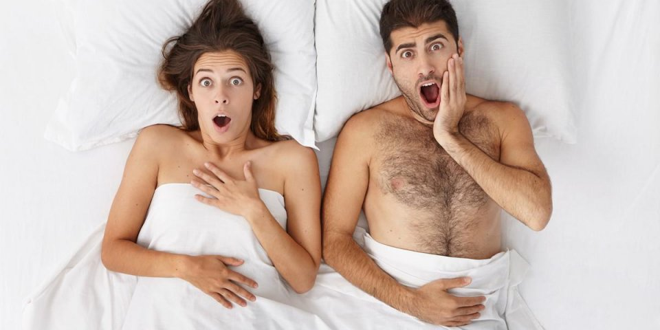 funny emotional couple in bed screaming in shock while being late for work or flight, having terrified looks and opening ...